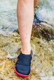 Kobieta w woda bucie Zdjęcia Stock