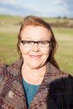 Kobieta wokoło sześćdziesiąt rok za granicą Zdjęcie Stock