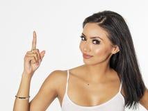 Kobieta wskazuje gestykulować upwards w kierunku teksta Zdjęcie Royalty Free