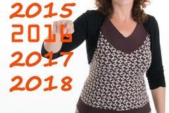 Kobieta wskazuje palec dla nowego roku Obrazy Royalty Free