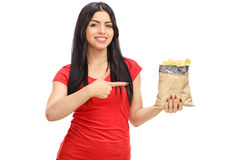 Kobieta wskazuje torba układy scaleni Zdjęcie Royalty Free