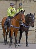 Kobieta Wspinający się funkcjonariuszi policji Obraz Royalty Free