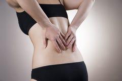 Kobieta z backache Ból w ciele ludzkim obrazy royalty free