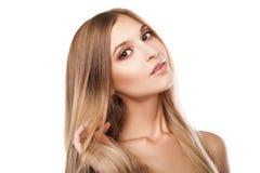 Kobieta z długimi prostymi blond hairs odizolowywającymi Obrazy Royalty Free