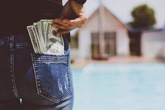 Kobieta z dolara pieniądze w jej kieszeni Fotografia Royalty Free