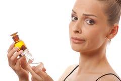 Kobieta z dwa butelkami medycyna lub pachnidło zdjęcia stock