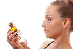 Kobieta z dwa butelkami medycyna lub pachnidło fotografia royalty free
