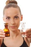 Kobieta z dwa butelkami medycyna lub pachnidło obrazy royalty free