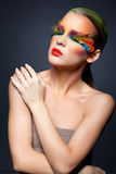 Kobieta z fałszywym piórkowym rzęsy makeup Zdjęcie Stock