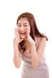 Kobieta z fartuchem ogłasza coś lub mówi Zdjęcia Stock