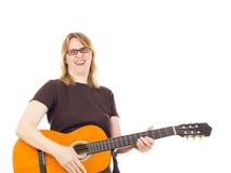 Kobieta bawić się gitarę obraz royalty free