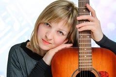kobieta z gitarą Obrazy Royalty Free