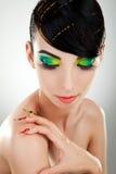 Kobieta z jaskrawy manicure'em i makeup Obrazy Stock