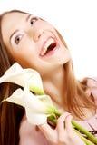 Kobieta z kalia kwiatami Obrazy Stock