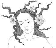 Kobieta z kwiatami w jej włosy Fotografia Royalty Free