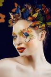 Kobieta z latem kreatywnie uzupełniał jak motyl Obraz Stock