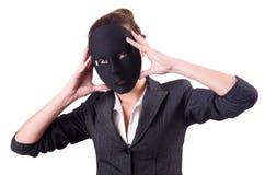 Kobieta z maską w hipokryzi pojęciu zdjęcie royalty free