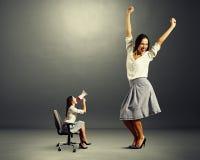 Kobieta z megafonem i byczą kobietą Fotografia Royalty Free