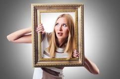 Kobieta z obrazek ramą Obrazy Royalty Free