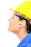 Kobieta z ochronnym wyposażeniem i zatyczka do uszu Zdjęcie Stock