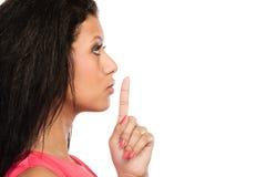 Kobieta z palcem na wargach pokazuje cisza gest obrazy stock