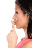 Kobieta z palcem na wargach pokazuje cisza gest obraz royalty free