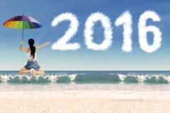 Kobieta z parasolem 2016 i liczbami Zdjęcia Stock