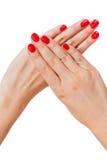 Kobieta z pięknymi robiącymi manikiur czerwonymi paznokciami Obraz Stock