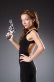 Kobieta z pistoletem przeciw zdjęcia royalty free