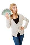 Kobieta z połysku pieniądze Zdjęcia Stock