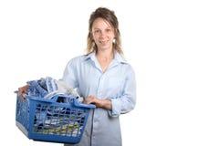 Kobieta z pralnianym koszem dla odprasowywać zdjęcia stock