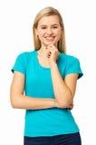 Kobieta Z ręką Na podbródku Przeciw Białemu tłu Zdjęcie Royalty Free