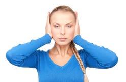 Kobieta z rękami na ucho fotografia stock