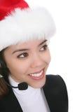 Kobieta z słuchawki przy Xmas Zdjęcia Stock