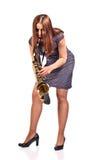 Kobieta z saksofonem odizolowywającym na bielu Fotografia Stock