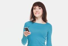 Kobieta z telefonem komórkowym na białym tle Obraz Royalty Free