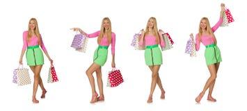 Kobieta z torba na zakupy odizolowywającymi na bielu Zdjęcia Royalty Free