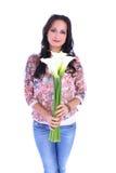 Kobieta z wiązką kwiaty obraz stock