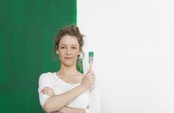 Kobieta z zieleni muśnięciem obraz royalty free