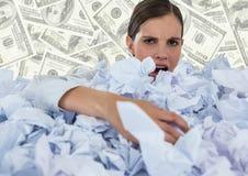 Kobieta zakrywająca w zmiętym papierze przeciw pieniądze tłu fotografia royalty free