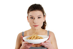 Kobiety łasowania spaghetti Obrazy Royalty Free
