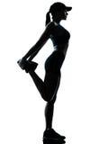Kobiety biegacza jogger rozciąganie grże grzać obraz stock