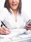 kobiety biznesowy kalkulatorski szczęśliwy writing Obrazy Stock