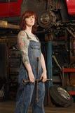 kobiety żelazna mechanika opona Obraz Royalty Free