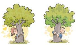 Kobiety i mężczyzna drzewa huggers. Zdjęcia Royalty Free
