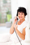 Kobiety kabel naziemny telefon Zdjęcia Stock