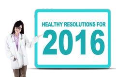 Kobiety lekarki przedstawienia zdrowy postanowienie dla 2016 Obraz Stock