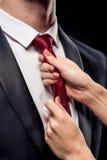 Kobiety mienia biznesmen krawatem Obrazy Royalty Free
