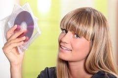 Kobiety mienia CDs Zdjęcie Stock