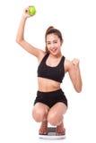 Kobiety na szalkowym dopingu dla dokonywać jej ciężar straty cel Zdjęcie Royalty Free